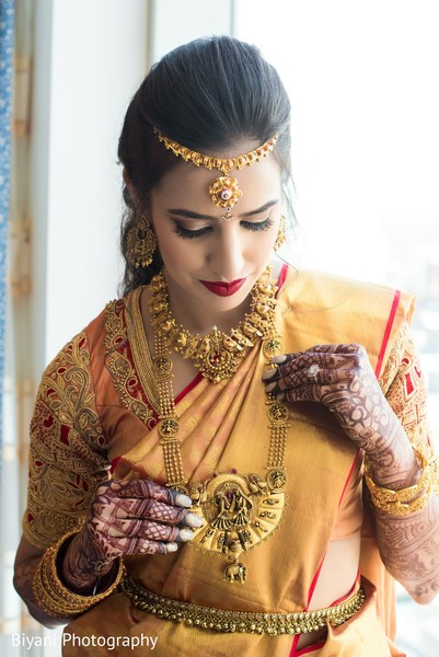 Maharani putting on her wedding ceremony jewelry.