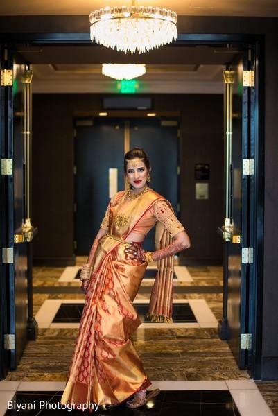 Maharani on her goldne and red Saree.