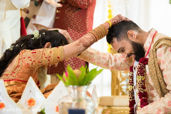 Indian birde and groom at wedding ceremony capture.