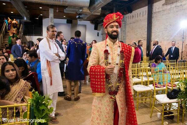 Indian groom walking in to wedding ceremony,