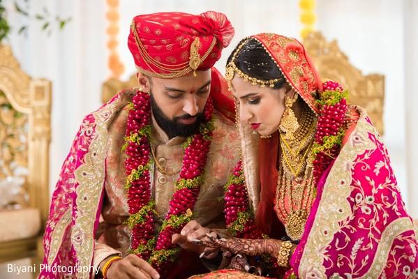 indian groom looking at mehndi.