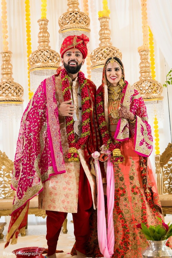 Indian couple at their wedding ceremony mandap.