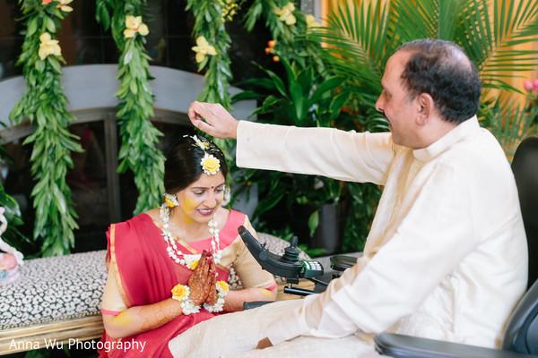 Indian bride at a pre-wedding ceremony ritual.