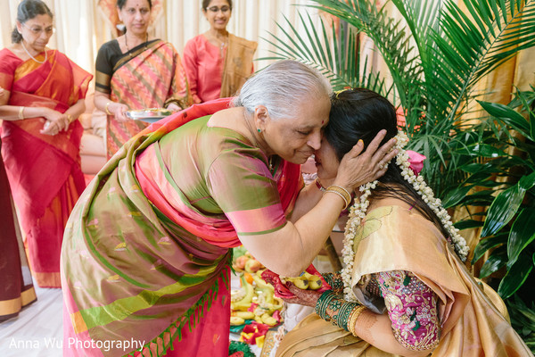 Relative hugging maharani at haldi ritual.