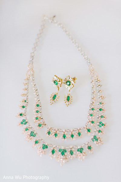 Maharani's yellow gold with white diamonds and green necklace set.