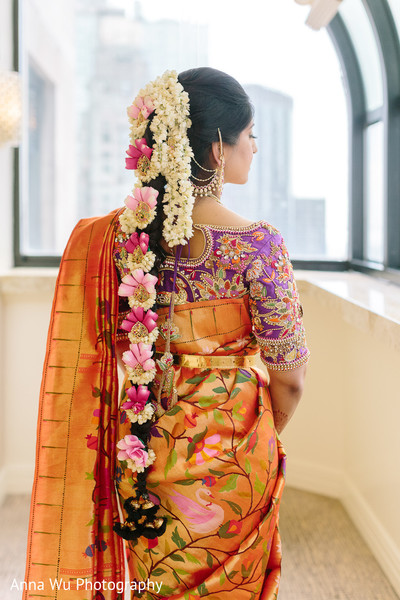 South Indian Bridal Hair style with white flowers.