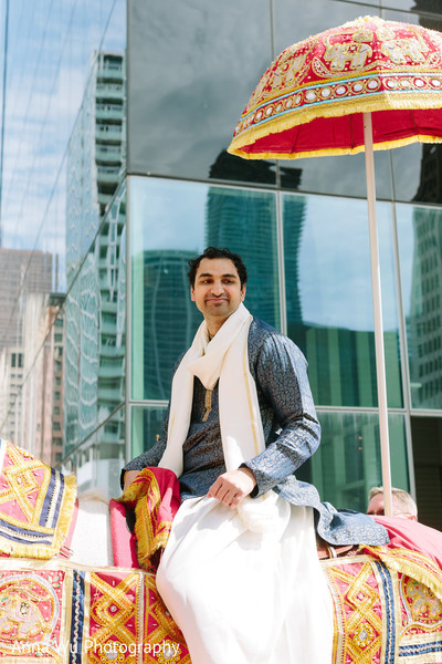 Indian groom riding his baraat horse.