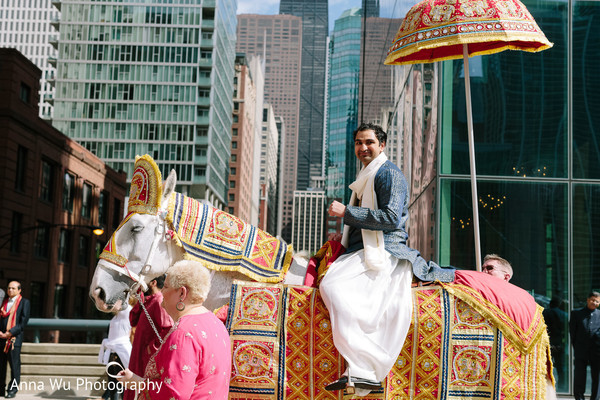 Indian groom on his white baraat horse.