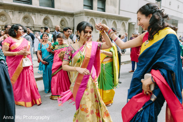 Indian girls at baraat procession with saris.