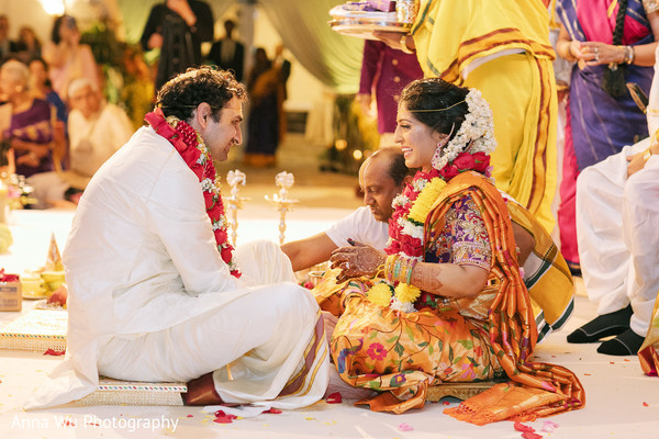 Indian couple during south indian wedding ritual.