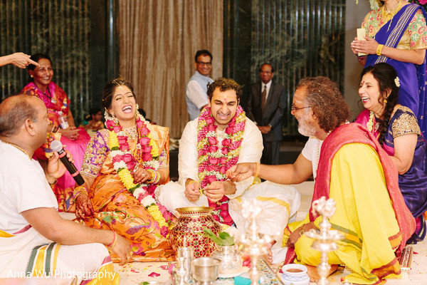 Joyful Indian couple at wedding ceremony.