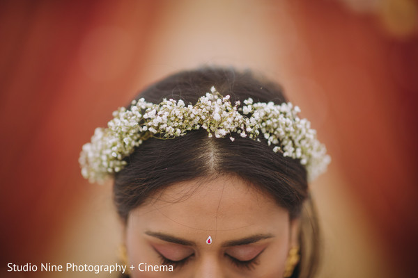 White flowers for Indian bridal pre-wedding hairstyle.