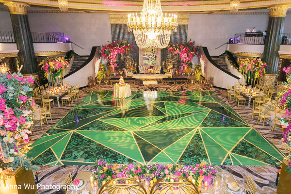 Green and golden Indian wedding reception dance floor.