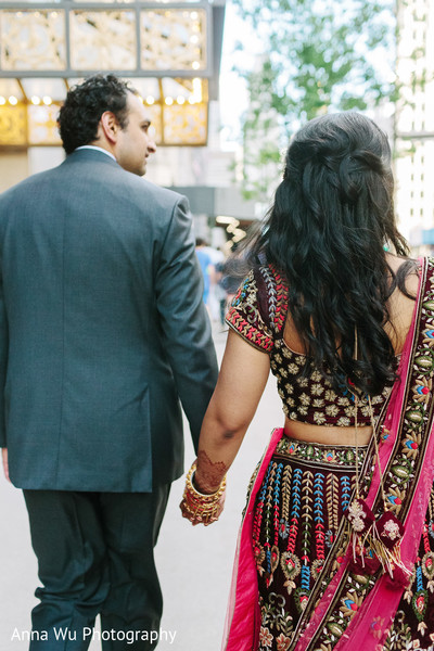 Indian couple holding hands photo.