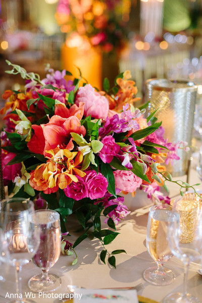 Orange and pink indian wedding table flowers.