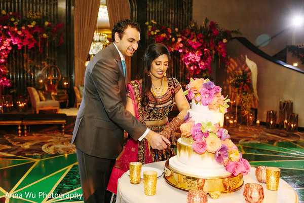 Indian couple cutting cake moment.