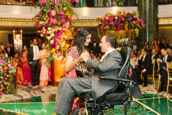 Maharani dancing with father at reception party.
