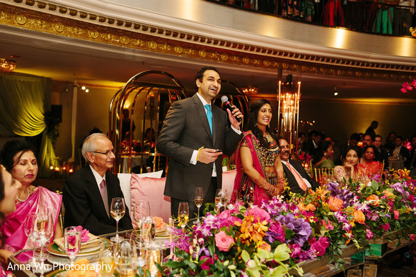Indian groom at wedding reception speech.