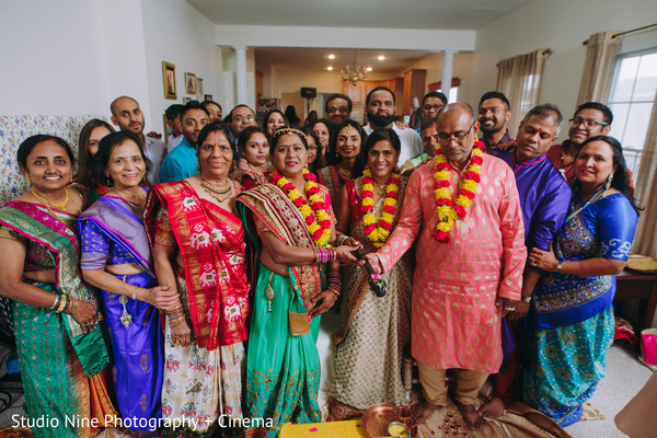 Indian bride with relatives at pre-wedding celebration.
