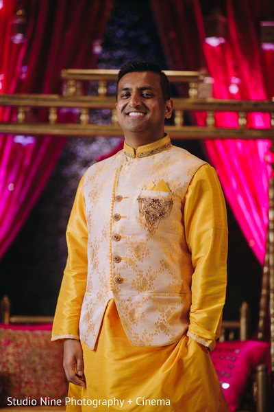 Indian groom on his yellow kurta.