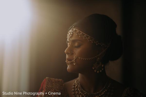 Maharani's Gold kundan matha patti and nose ring.