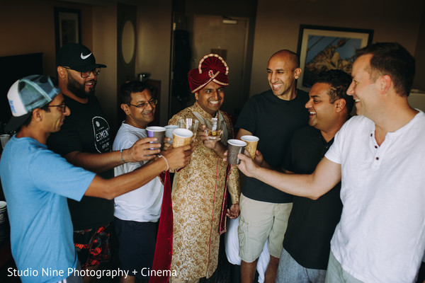 Raja with groomsmen having a toast.