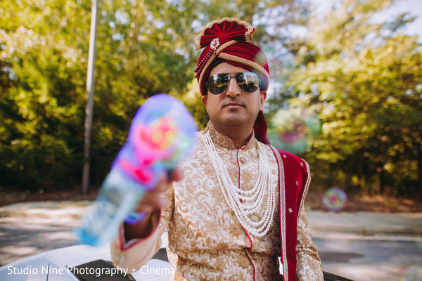 Indian groom at his baraat celebration capture.