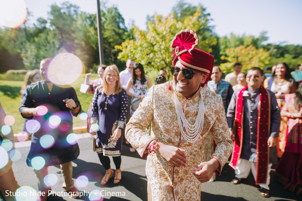 Indian groom at his outdoors baraat celebration.