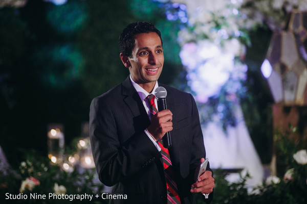 Indian groomsman at wedding reception speech.