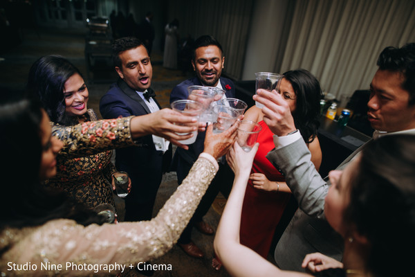 Indian couple having a toas at reception party.
