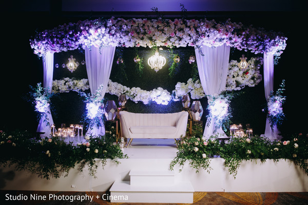 Indian wedding reception stage white and pink flowers decor.
