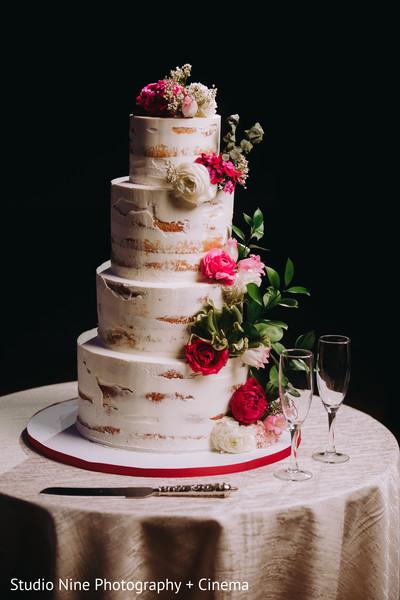 Indian wedding white cake decorations.