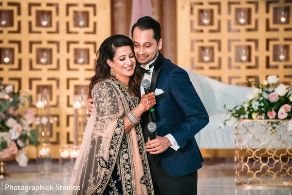 Indian couple at wedding reception speech.