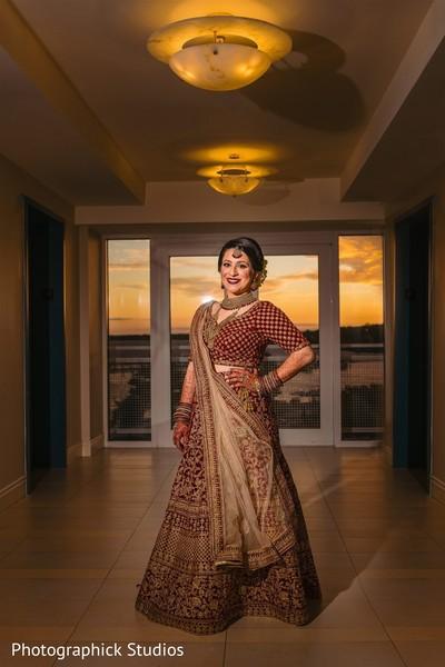 Maharani posing in her ceremony lehenga.