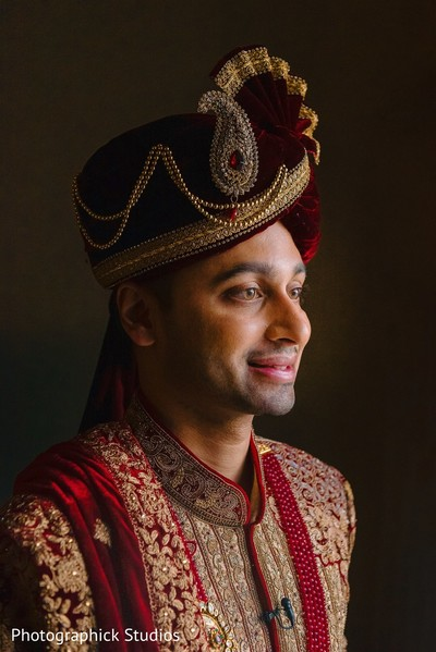 Raja's portrait in hes Indian wedding ceremony red outfit.