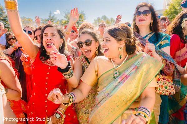 Indian bridesmaids at baraat celebration.