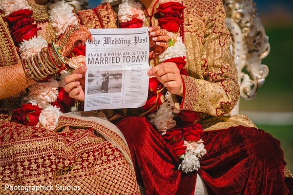 Indian couple holding the wedding News.