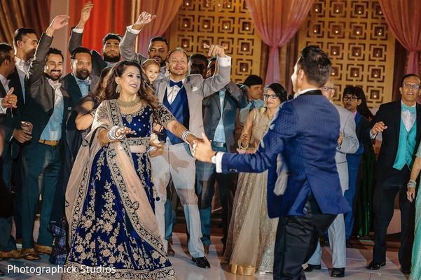 maharani and raja dancing at reception party.