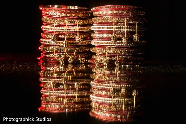 Red and golden indian bridal's braceletes.
