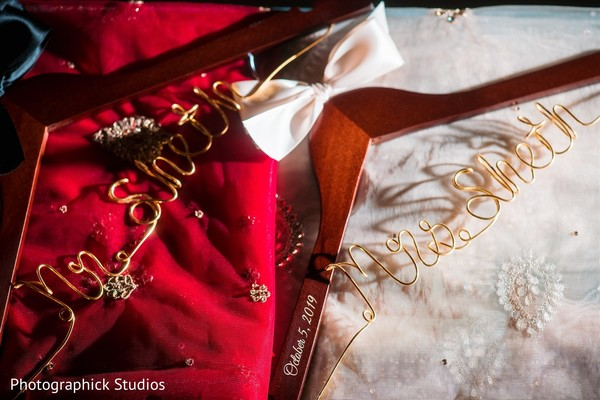 Indian groom and bride's personalized hangers.