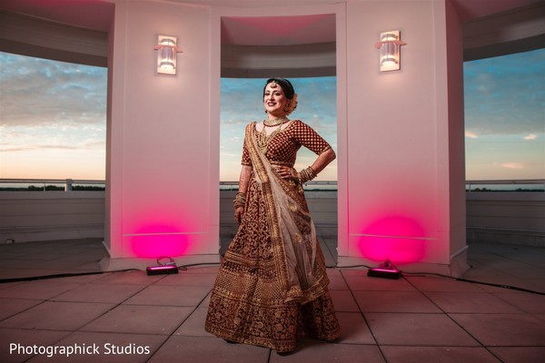 Indian bride in her red and golden lehenga.