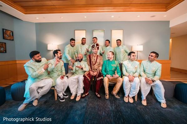 Indian groom possing with groomsmen capture.