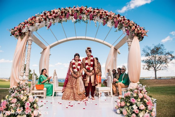 Indian bride and groom with jaimalas on.