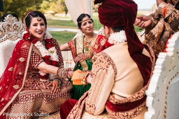 Maharani and raha at holding hands ritual.