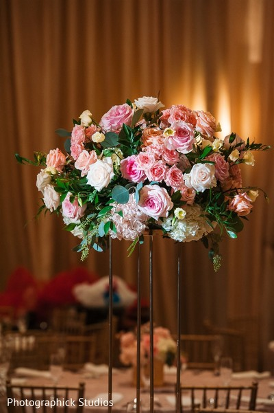 Indian wedding tall table roses centerpiece.