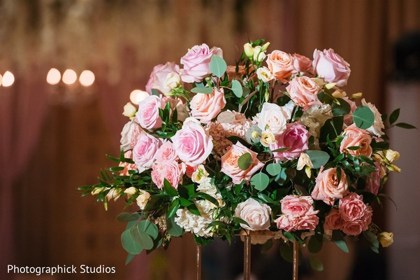Pink and orange roses for Indian wedding table decoration.