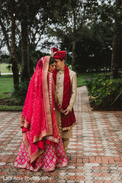 Indian bride and groom at first look capture.