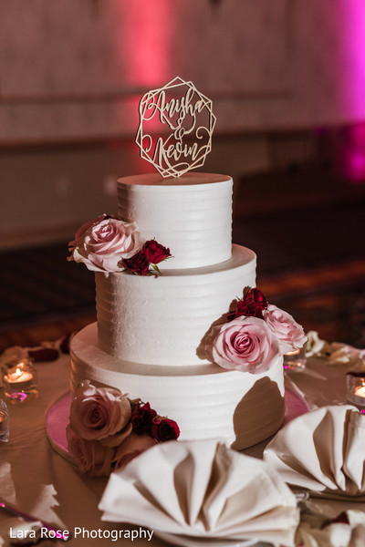 White indian wedding cake with flowers decorations.