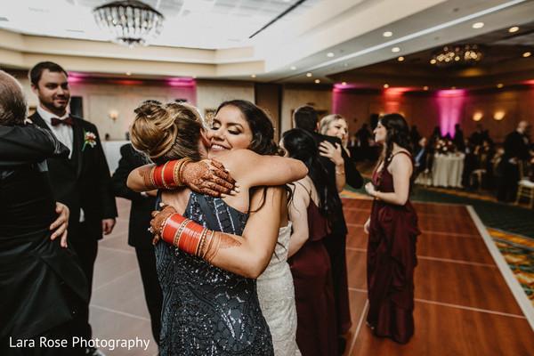Indain bridal reception hug.