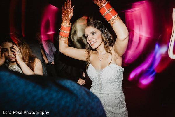 Maharani dancing at wedding reception party.